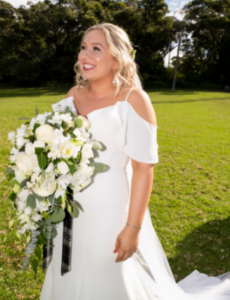 Bride with white and green bouquet