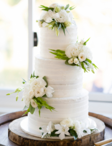 white tiered wedding cake with flowers