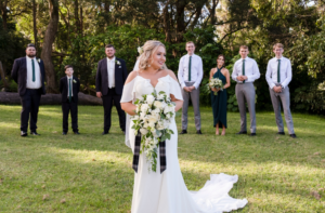 Bride standing in front of wedding party at Sublime Point
