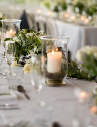 candles and greenery reception table setting