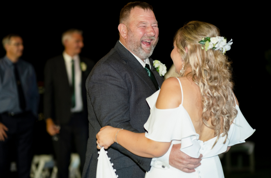 Father laughing during father daughter dance at Wollongong wedding