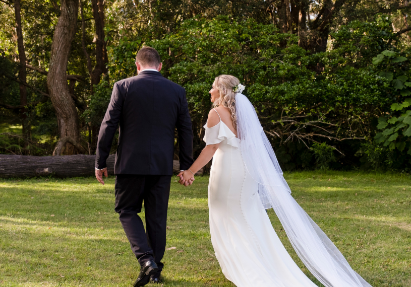Bride and groom holding hands - Sublime Point Lookout Wollongong