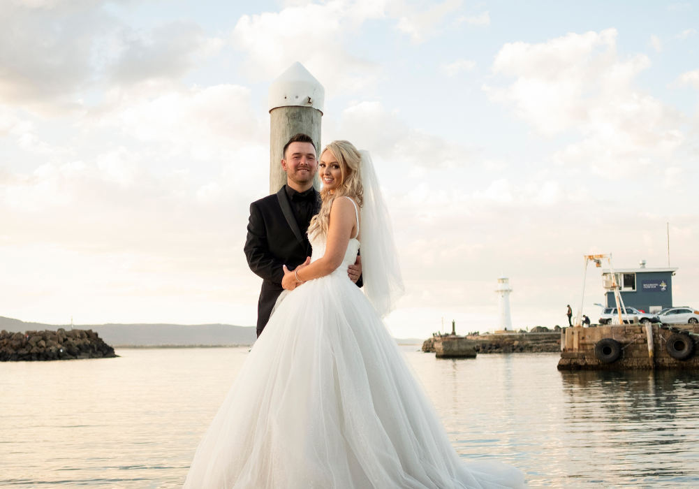 Bride and groom on jetty in Sydney